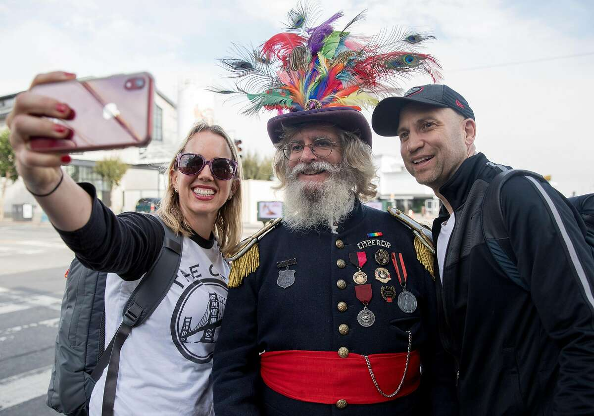 San Francisco Chronicle reporters Heather Knight (left) and Peter Hartlaub (right) pose for a selfie with Emperor Norton while at Fisherman's Wharf in San Francisco, Calif. Wednesday, September 4, 2019 as Knight and Hartlaub attempt to traverse San Francisco�s 49-mile Scenic Drive without using a car.