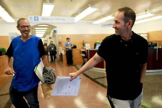 Jason Dedmon (left), 54, of Coarsegold, CA, and his brother Brad Dedmon (left), 48, of Clovis, CA, converse during a visit to UCSF - Parnassus in San Francisco, Calif., on Wednesday, September 4, 2019. Jason Dedmon, who has liver disease/liver cancer, will be getting a transplant from his brother later this month.