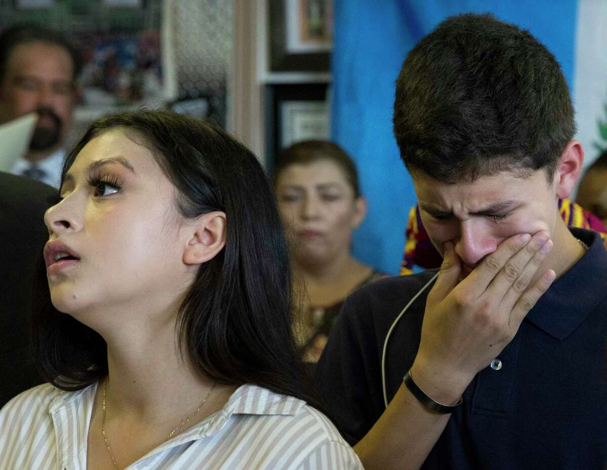 Tears run down Roland Gramajo Jr.'s cheek while his sister, Katherine Gramajo, 18, is talking about their father, Roland Gramajo, who is being detained at a detention facility in Conroe, during a press conference on Friday, Sept. 6, 2019, in Houston. The 40-year-old was arrested by U.S. Immigration and Customs Enforcement while going to work on Thursday. Gramajo, a Guatemala native, has five U.S. citizen children and a legal resident wife.