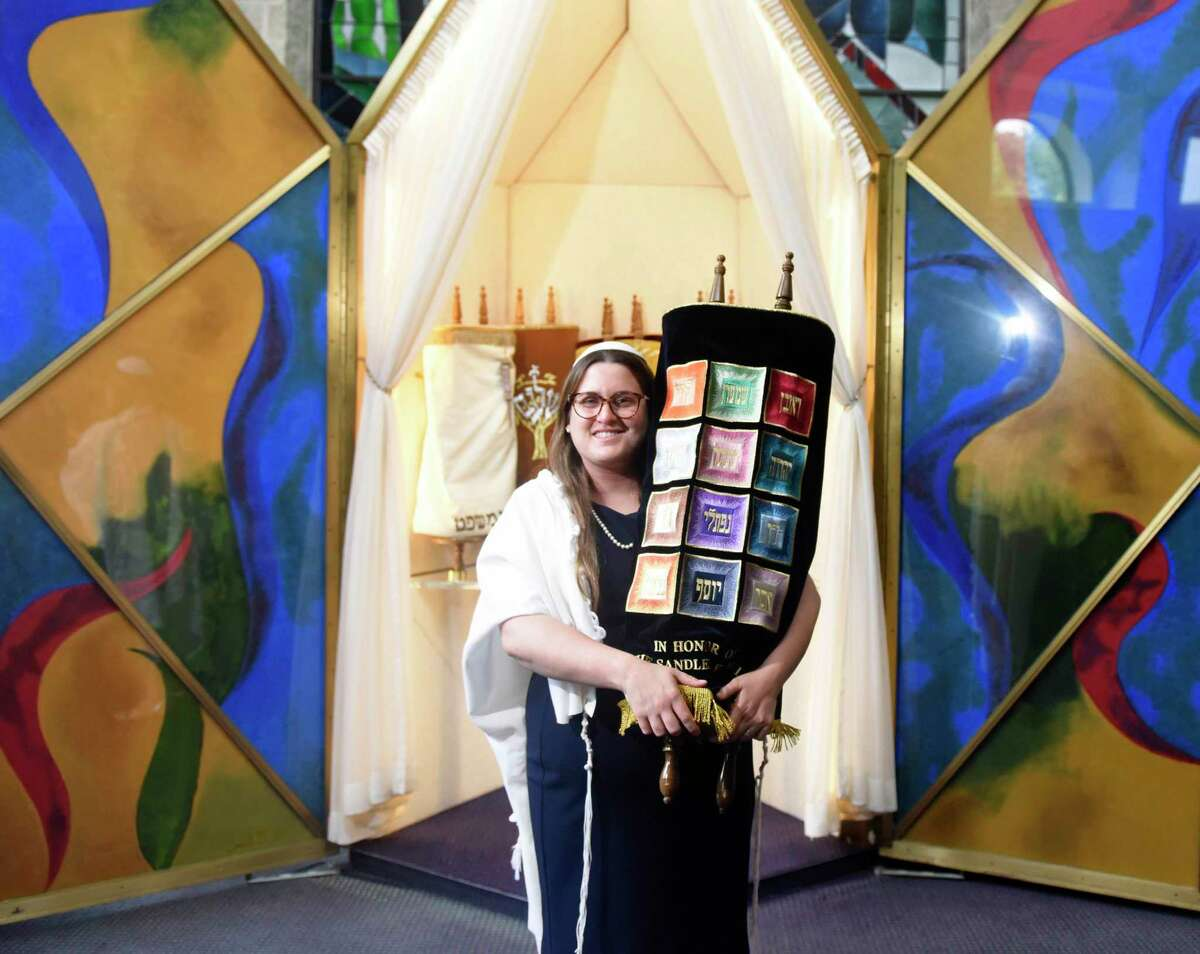 Assistant Rabbi Chaya Bender poses in the sanctuary at Temple Sholom in Greenwich, Conn. Wednesday, Sept. 4, 2019. Rabbi Bender first joined Temple Sholom as a Rabbinic Fellow in 2016 and has held the roles of Assistant Rabbi, youth director, seventh-grade teacher, and Judah BBYO Chapter Advisor.