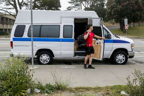 (6:47:09 AM/Frida Kahlo Way between Judson Avenue and Ocean Way) With backpack of shower supplies slug across his shoulder, Jimmie Wu closes the door to the van he has been living in for the last two years as he heads to the City College of San Fransisco Wellness Center to shower Tuesday, June 18, 2019, in San Francisco, Calif. Living in a van has presented challenges such as finding places to shower and go to the bathroom. As a City College student, Wu uses their facilities regularly.