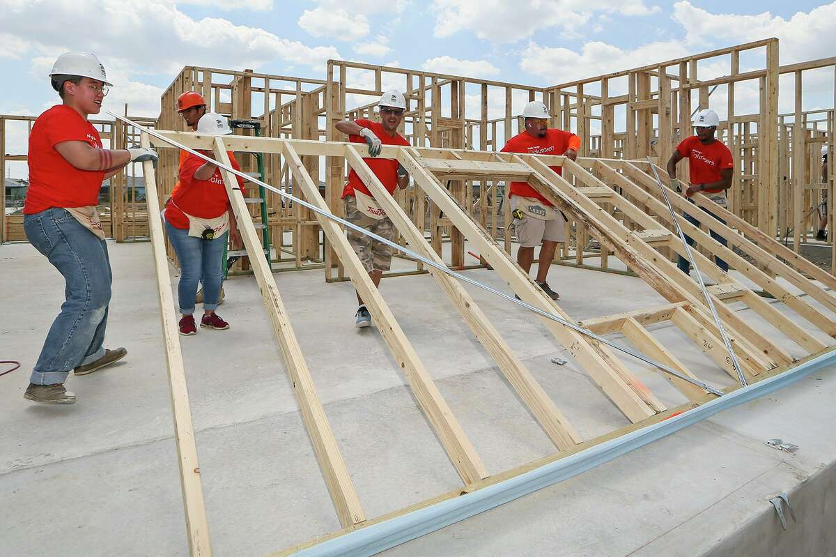 Habitat for Humanity volunteers Justine Blakemore, Joy Moore, John Ray, Arnulfo Aguilar and Kellan Lowry, all with Wells Fargo, lift a wall frame into place while building a new home in the Lenwood Heights subdivision on Friday, Sept. 6, 2019. The nonprofit is building 10 homes expected to be ready before the holidays.