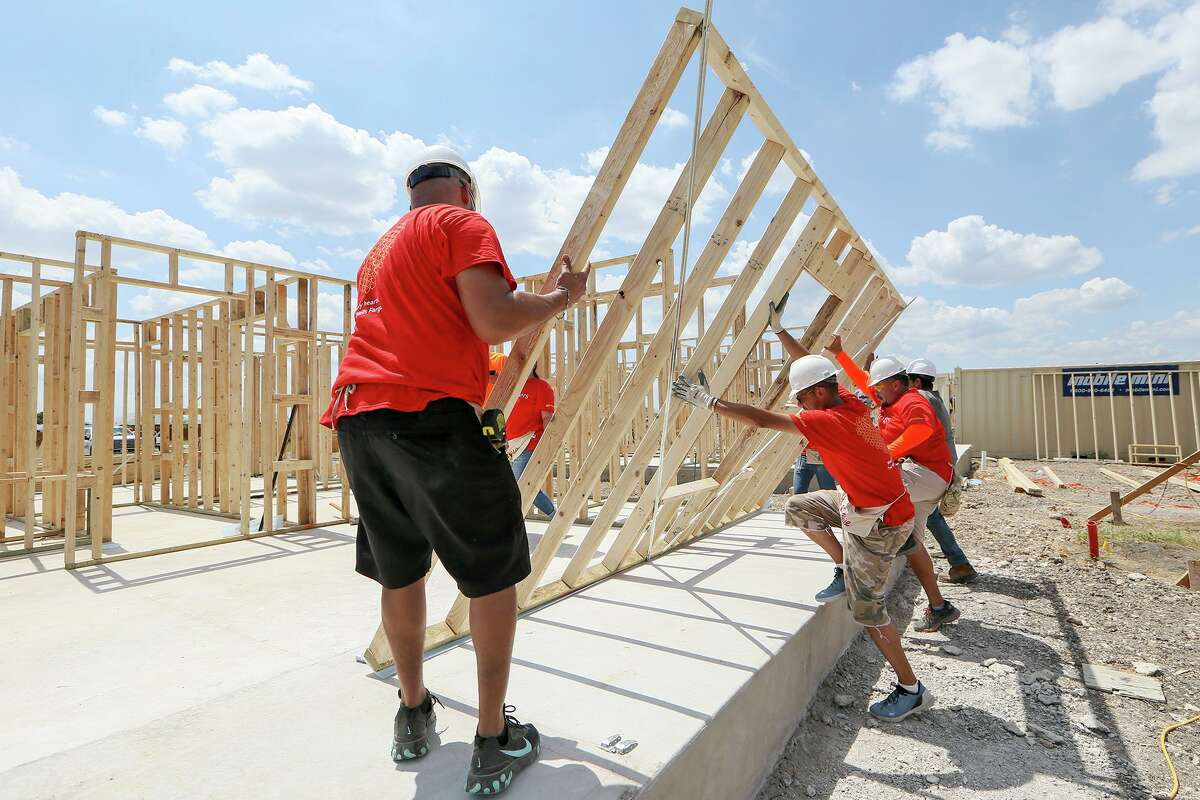 Habitat for Humanity volunteers from Wells Fargo lift a wall frame into place while building a new home in the Lenwood Heights subdivision on Friday, Sept. 6, 2019. The nonprofit is building 10 homes expected to be ready before the holidays.