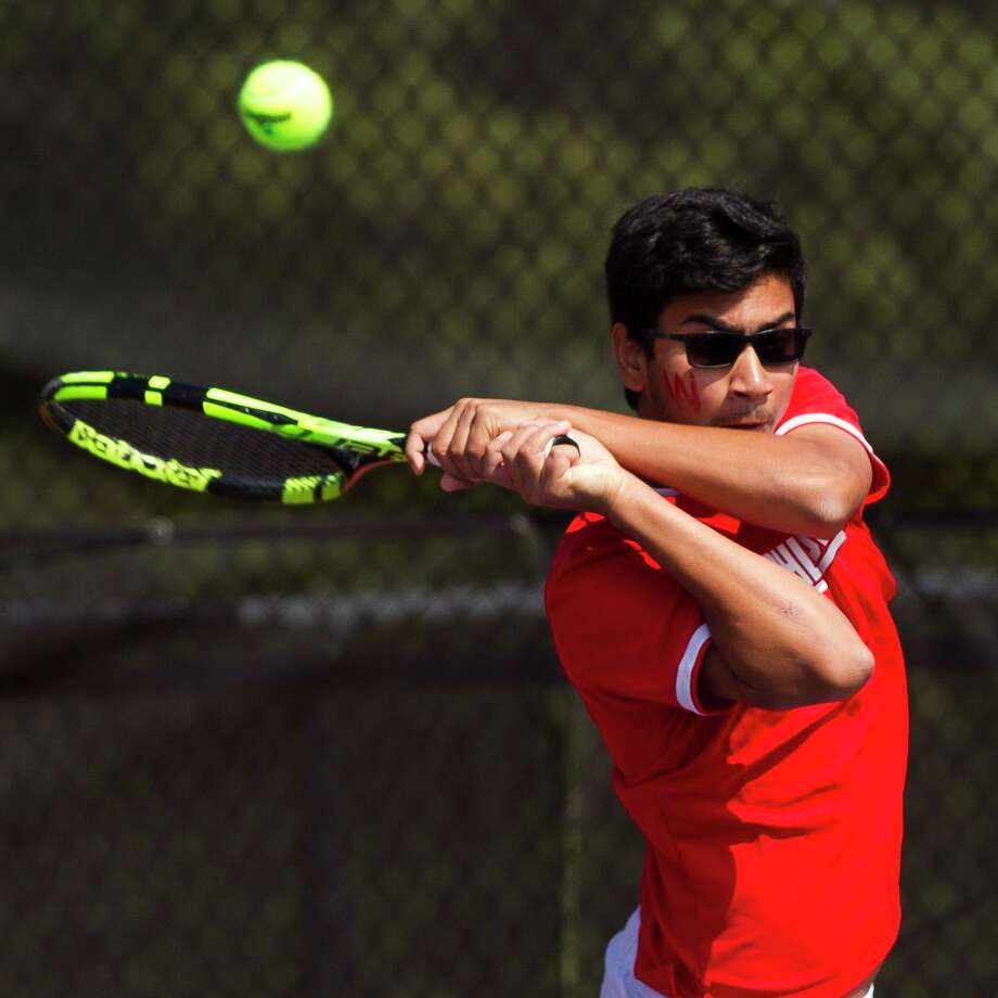 Rock Kanzarkar of The Woodlands returns a serve in the boys doubles finals during the District 12-6A tennis tournament at The Woodlands High School, Thursday, April 5, 2018, in The Woodlands. Photo: Jason Fochtman, Staff Photographer / Houston Chronicle / © 2018 Houston Chronicle