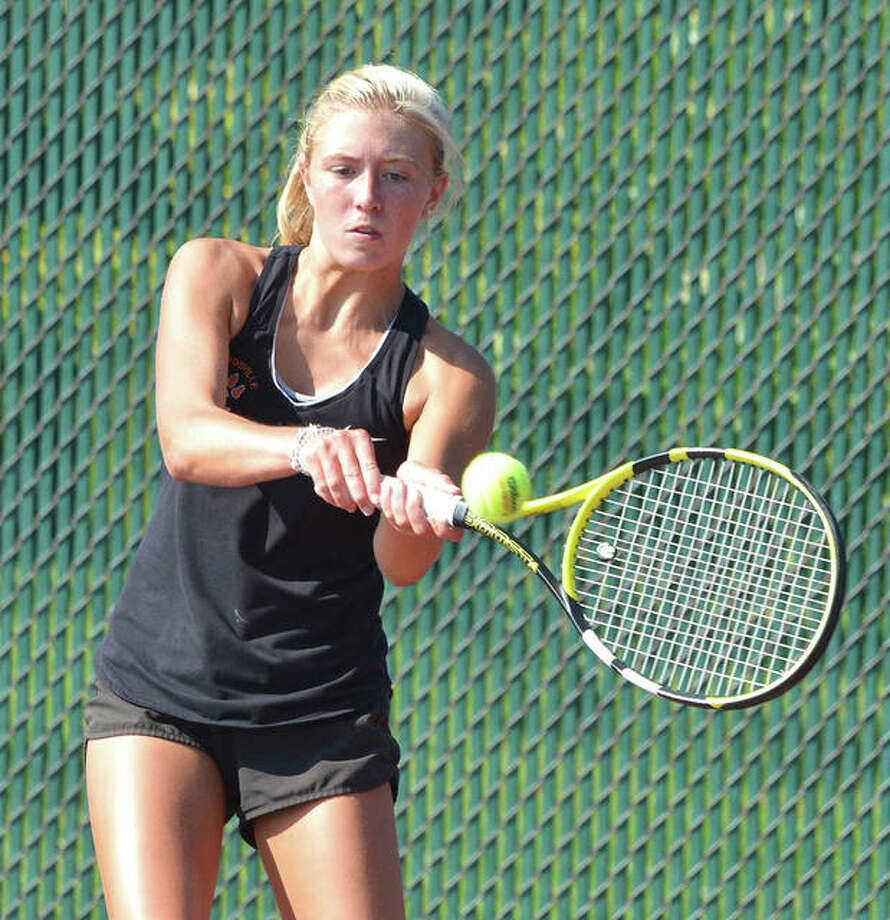 Edwardsville's Emma Herman hits a two-handed backhand on Friday during her No. 3 doubles match against Maine South in the opening round of the Heather Bradshaw Memorial Invitational. Photo: Scott Marion/The Intelligencer