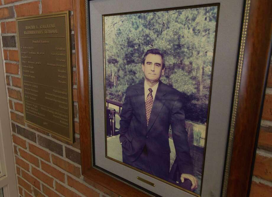 A portrait Roger Galatas hangs in the Conroe ISD elementary school named after him, Friday, Sept. 6, 2019, in The Woodlands. Galatas, and was one of the key figures in the development of The Woodlands, died at the age of 83 on Aug. 29. He served as president and CEO of The Woodlands Operating Company for 20 years, helped found The Cynthia Woods Mitchell Pavilion; was a founding director of The Woodlands Hospital, now Memorial Hermann The Woodlands Medical Center, and The John Cooper School. He was also a past president of the Conroe Independent School District with a school named in his honor, Galatas Elementary School. Photo: Jason Fochtman, Houston Chronicle / Staff Photographer / Houston Chronicle