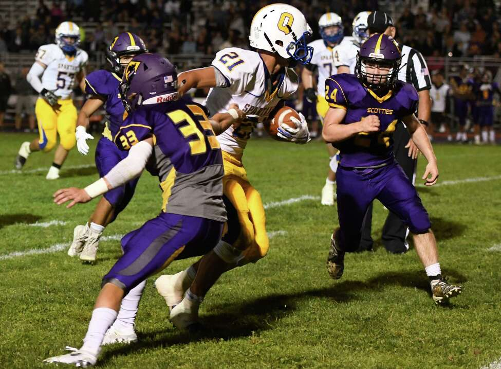 Queensbury running back Jason Rodriguez pushes past Ballston Spa defensive back Erik Gottman for a first down during their first game of the season on Friday, Sept. 6, 2019, in Ballston Spa, N.Y. (Jenn March, Special to the Times Union )