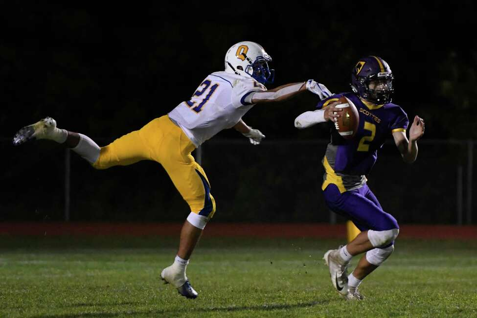 Queensbury defensive back Jason Rodriguez attempts to stop a throw by Ballston Spa quarterback Keegan Zoller during their first game of the season on Friday, Sept. 6, 2019, in Ballston Spa, N.Y. (Jenn March, Special to the Times Union )