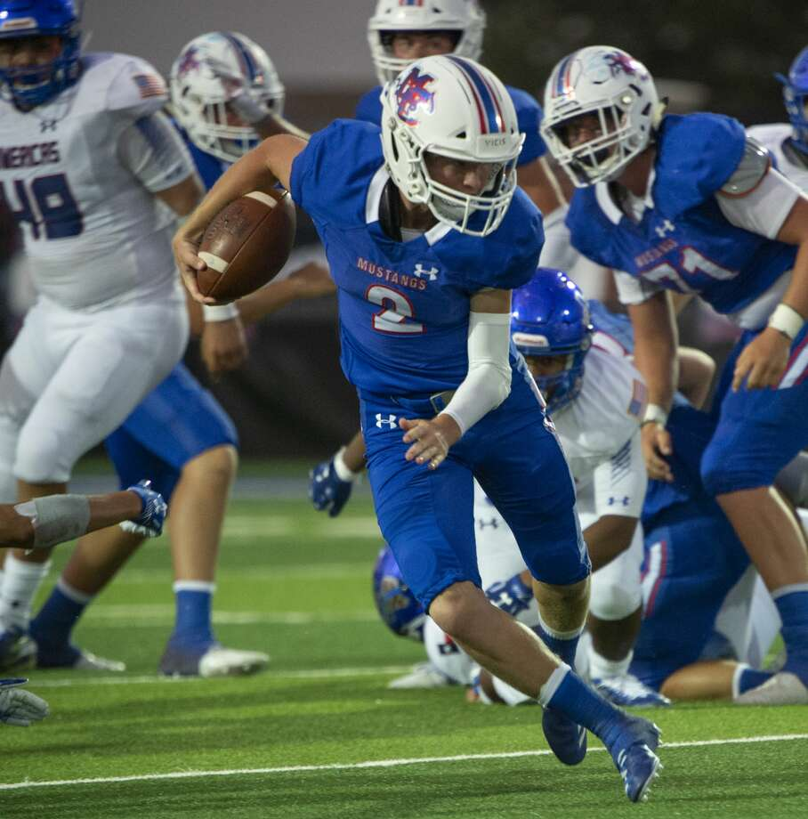 Midland Christian's Tanner Carlisle looks for more yards as he runs the ball 09/06/19 against El Paso Americas at Gordon Awtry Stadium. Tim Fischer/Reporter-Telegram Photo: Tim Fischer/Midland Reporter-Telegram