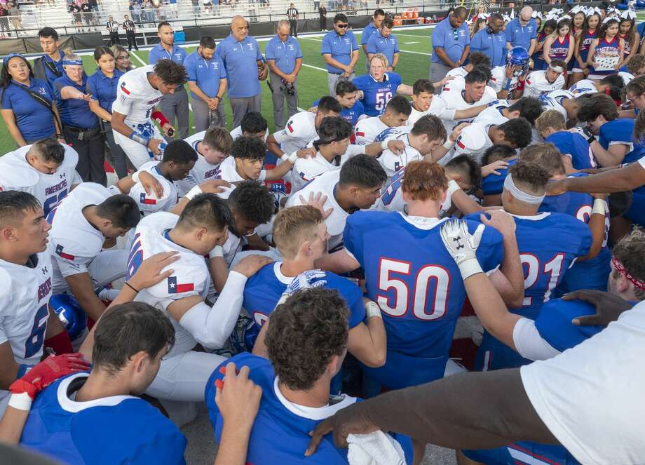 Midland Christian players and coaches come together with El Paso Americas' players and coaches at the 50 yard line 09/06/19 before the game at Gordon Awtry Stadium for a prayer for victims from both cities from recent shooting tragedies. Tim Fischer/Reporter-Telegram Photo: Tim Fischer/Midland Reporter-Telegram