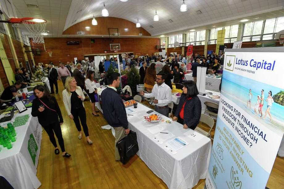 """Small businesses exhibit in April 2019 at a Greenwich, Conn. showcase sponsored by the Greenwich Chamber of Commerce. The Connecticut Department of Revenue Services is waiving penalties for some 10,000 businesses statewide late filing taxes, after confusion over changes to Connecticut tax law following the 2018 enactment of a new filing option for """"pass-through"""" entities like limited liability companies and partnerships. Photo: Matthew Brown / Hearst Connecticut Media / Stamford Advocate"""
