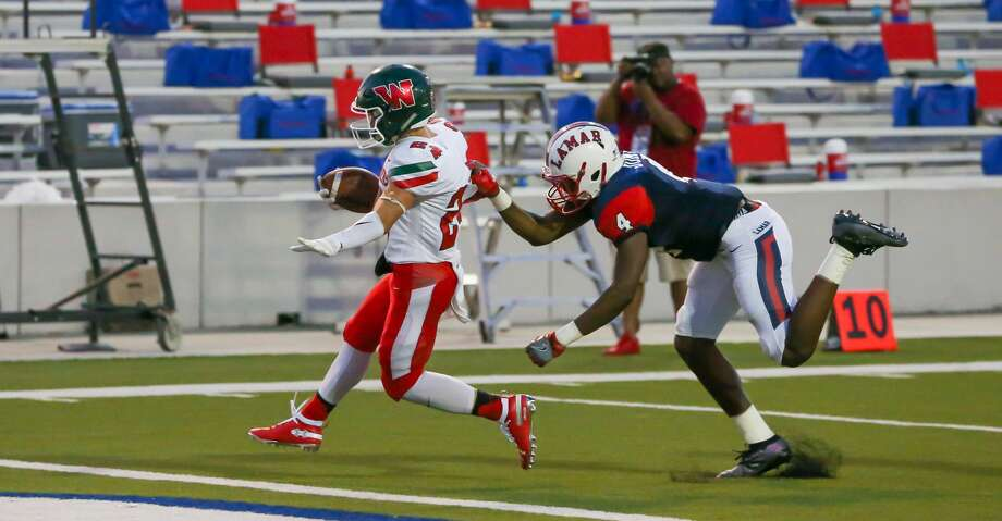 The Woodlands Highlanders Diego Zimmerman evades a tackle by Lamar Texans defensive back Kobe Jones to score a touchdown during the high school football game between the Lamar Texans and The Woodlands Highlanders at Delmar Stadium in Houston, Texas on September 6, 2019. Photo: Leslie Plaza Johnson/Contributor
