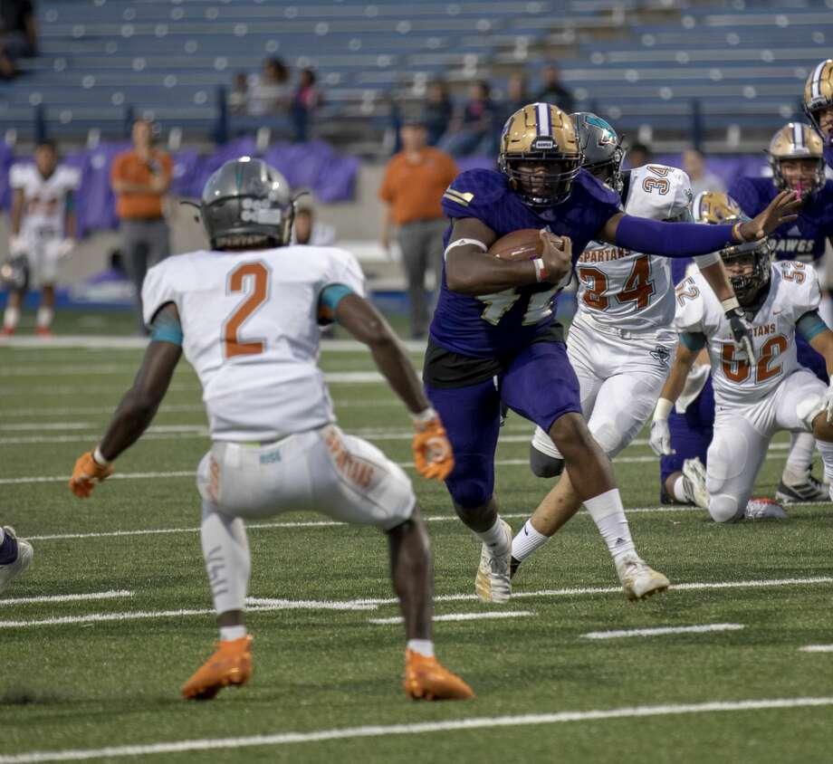 Midland High's Jordan Springer runs the ball on Friday, Sept. 6, 2019 at Grande Communications Stadium. Photo: Jacy Lewis/Reporter-Telegram
