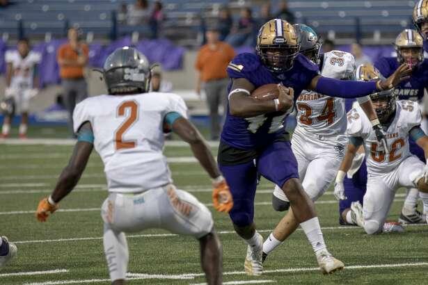 Midland High's Jordan Springer runs the ball on Friday, Sept. 6, 2019 at Grande Communications Stadium.