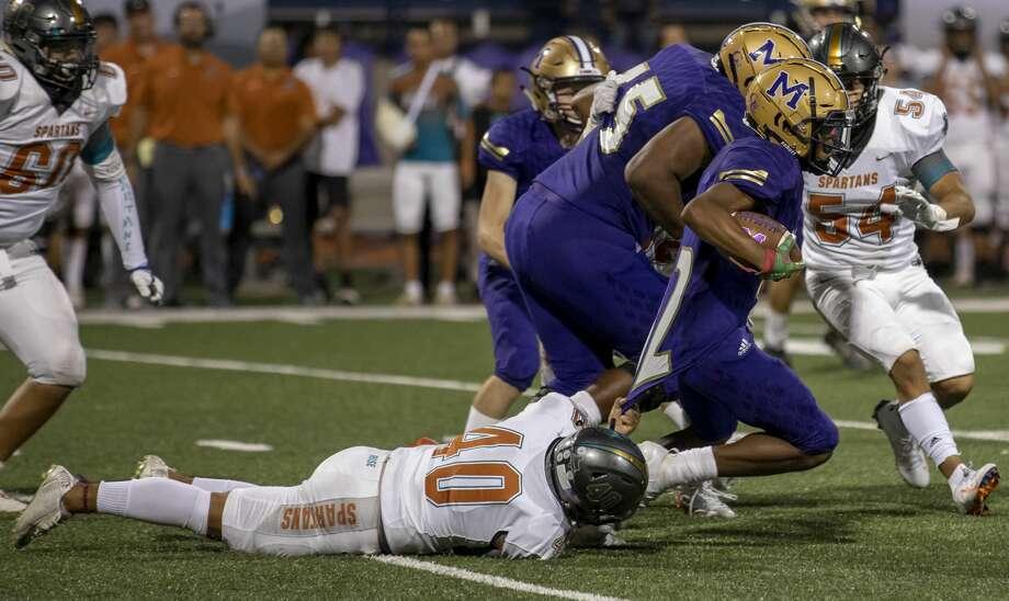 Pebble Hills' Nate Mesa (40) brings Midland High's Daniel Garcia down by his jersey Friday, Sept. 6, 2019 at Grande Communications Stadium. Photo: Jacy Lewis/Reporter-Telegram