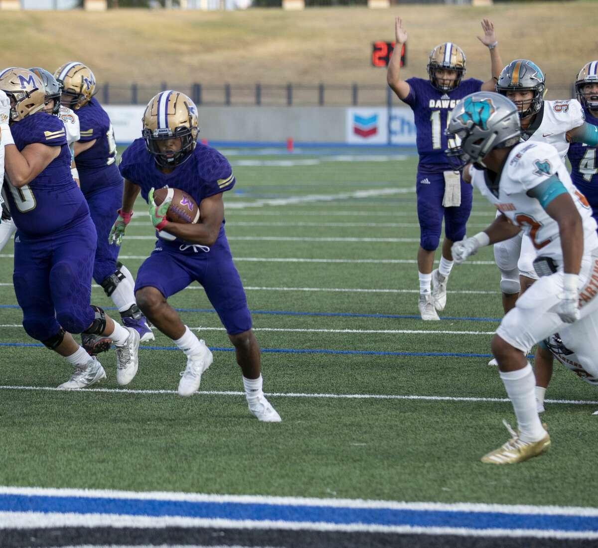 Midland High's Daniel Garcia scores a touchdown Friday, Sept. 6, 2019 at Grande Communications Stadium.
