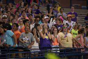 The student section reacts to a fight on the field Friday, Sept. 6, 2019 at Grande Communications Stadium.