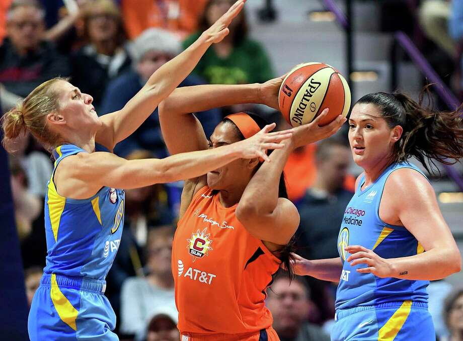 Chicago Sky guard Allie Quigley, left, and center Stefanie Dolson defend against Connecticut Sun center Brionna Jones during a WNBA basketball game Friday, Sept. 6, 2019, in Uncasville, Conn. (Sean D. Elliot/The Day via AP) Photo: SEAN D. ELLIOT / Associated Press / 2019 The Day Publishing Company