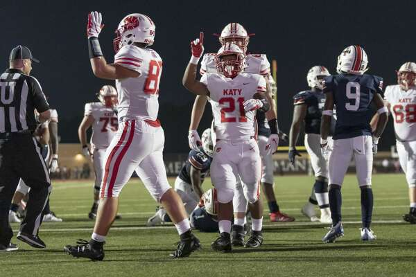 Katy running back Sherman Smith (21) celebrates after scoring a touchdown in the first half of a high school football game Friday, Sep 6, 2019, in Humble, Texas.