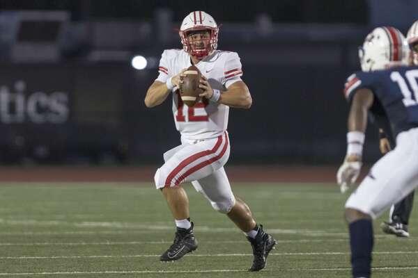 Katy quarterback Bronson McClelland (12) scrambles for a 3-yard run during the first half of a high school football game Friday, Sep 6, 2019, in Humble, Texas.