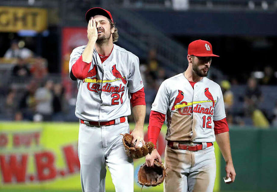 Cardinals relief pitcher Andrew Miller (21) is joined by Paul DeJong as he waits to hand the ball to manager Mike Shildt after giving up an RBI single to the Pirates' Melky Cabrera in the seventh inning of Friday night's game in Pittsburgh. Photo: AP Photo