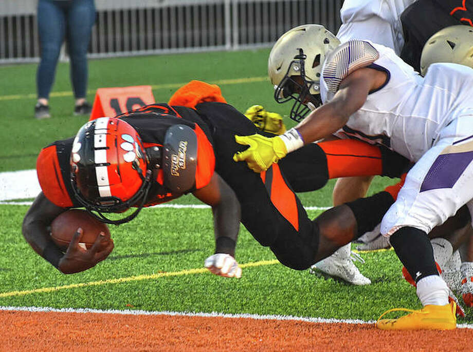 Edwardsville running back Justin Johnson Jr. dives into the endzone for the first of his career-high four touchdowns. Photo: Matt Kamp|The Intelligencer