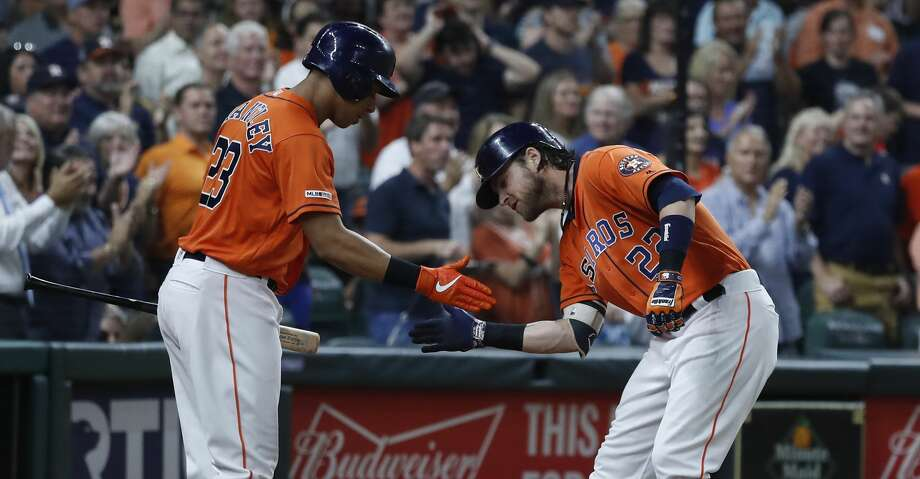 Houston Astros Josh Reddick (22) celebrates his home run with Michael Brantley (23) during the fourth inning of an MLB baseball game at Minute Maid Park, Friday, Sept. 6, 2019, in Houston. Photo: Karen Warren/Staff Photographer