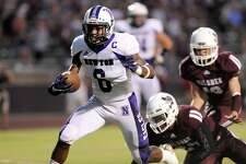 Newton Eagles Kevin Watson, 6, runs for a gain aginst the Silsbee Tigers Friday night in Silsbee. Photo: Drew Loker/Special to The Enterprise