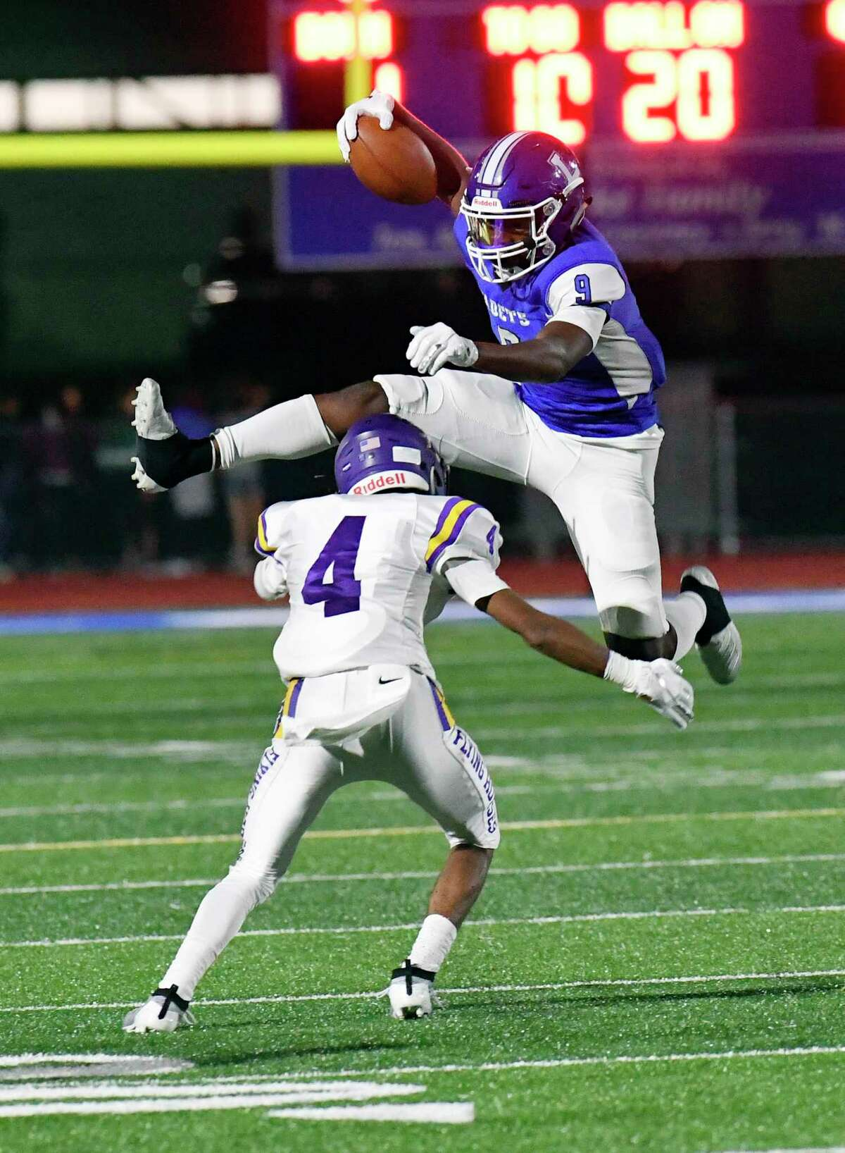 La Salle Institute's Traydon Lawrence (9) jumps over Troy's Makai Cruel (4) while running the ball during the first half of a Section II High School football game Friday, Sept. 6, 2019, in Troy, N.Y. (Hans Pennink / Special to the Times Union)