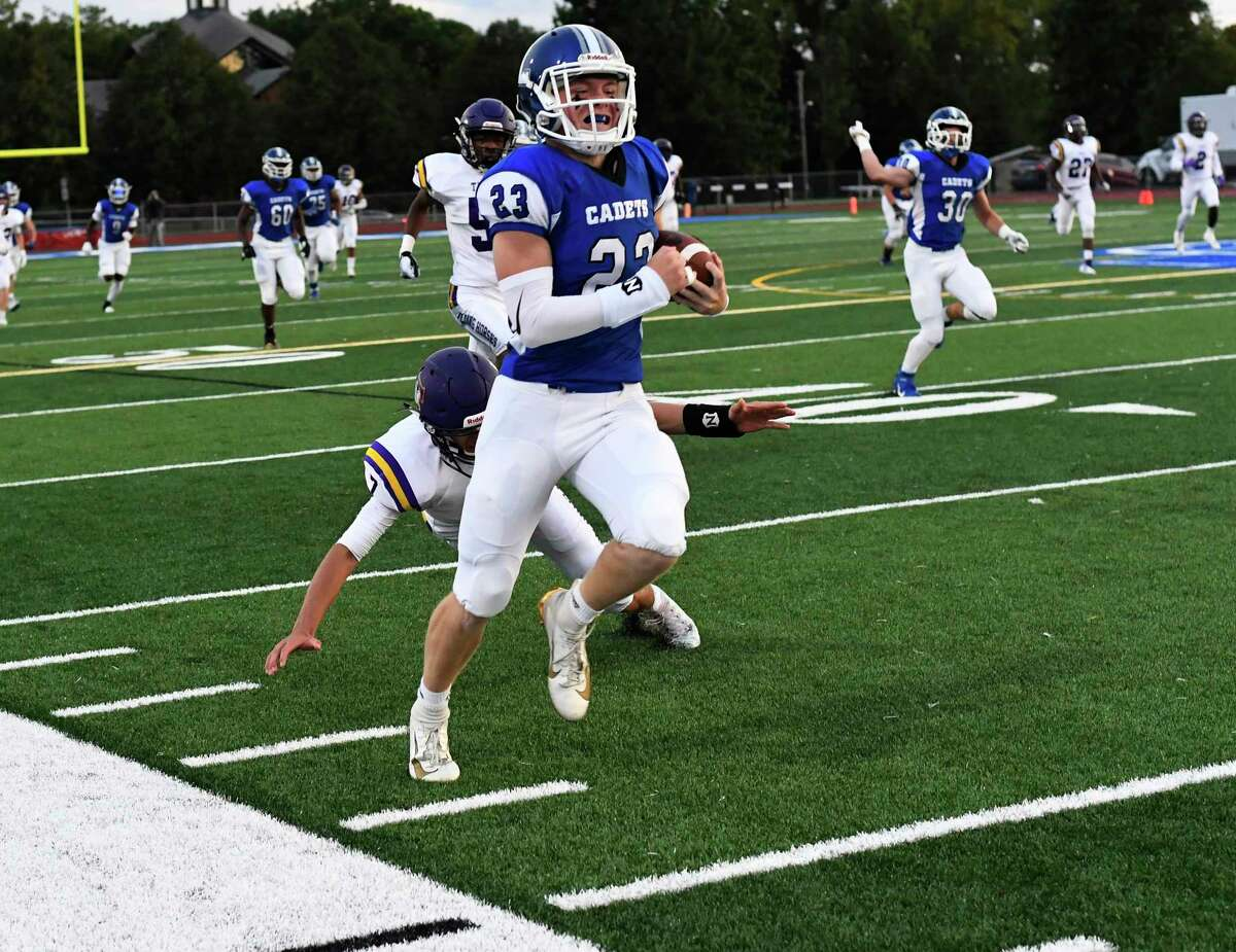 La Salle Institute's Bo Catherwood (23) runs for a touchdown against Troy during the first half of a Section II High School football game Friday, Sept. 6, 2019, in Troy, N.Y. (Hans Pennink / Special to the Times Union)