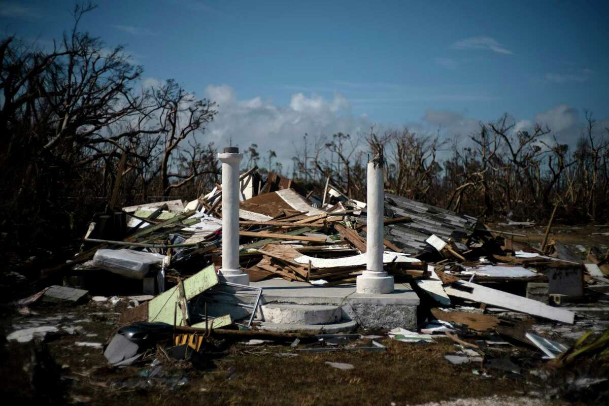 """The portico of a house destroyed by Hurricane Dorian is the only thing that stands of the structure, destroyed by Hurricane Dorian, in High Rock, Grand Bahama, Bahamas, Thursday Sept. 5, 2019. At least 30 people died in the hurricane and the number could be """"significantly higher,"""" Bahamian health minister Duane Sands told The Associated Press in a telephone interview late Thursday."""