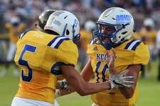 Kelly's Jackson Lapray, left, and Dane Seay celebrate after Lapray scored a touchdown during the first half of the game at Kelly High School Friday night. Photo taken on Friday, 09/06/19. Ryan Welch/The Enterprise