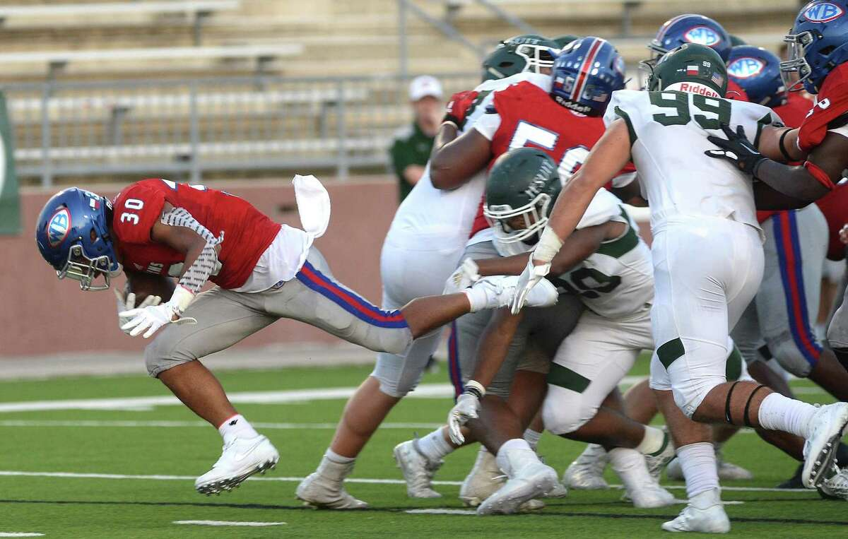 West Brook's Jordan Guidry busts out of Strake Jesuit's tackle attempt during Friday night's match-up at BISD Memorial Stadium. Photo taken Friday, September 6, 2019 Kim Brent/The Enterprise