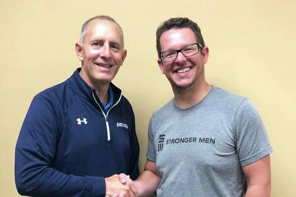 Left, Todd Cramer, executive director of Bluewater Thumb Youth for Christ, welcomes Cyle Harless as the new Bad Axe Campus Life Director. (Submitted Photo)