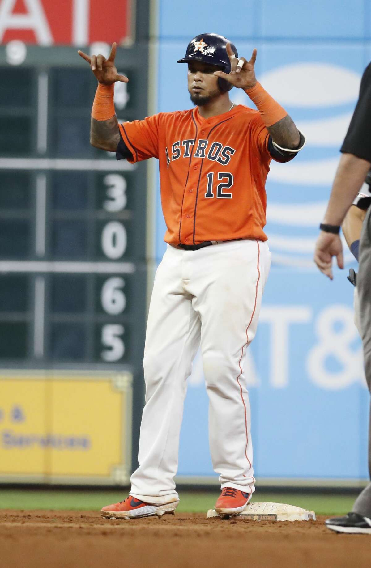 Houston Astros Martin Maldonado (12) gestures back to the dugout after hitting a double during the sixth inning of an MLB baseball game at Minute Maid Park, Friday, Sept. 6, 2019, in Houston.