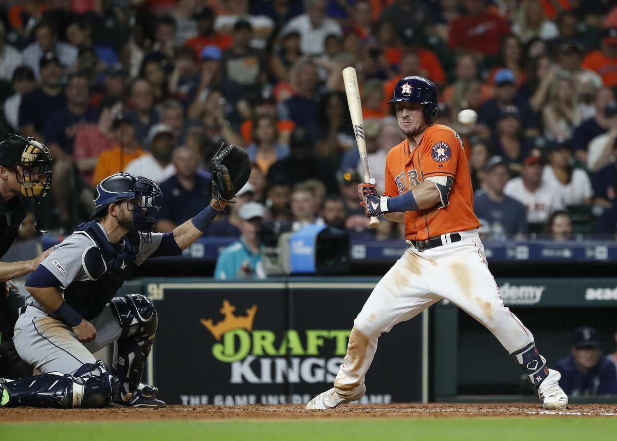 Houston Astros Alex Bregman (2) jumps back from a passed ball thrown by Seattle Mariners Dan Altavilla, which allowed Jose Altuve to score a run during the sixth inning of an MLB baseball game at Minute Maid Park, Friday, Sept. 6, 2019, in Houston.