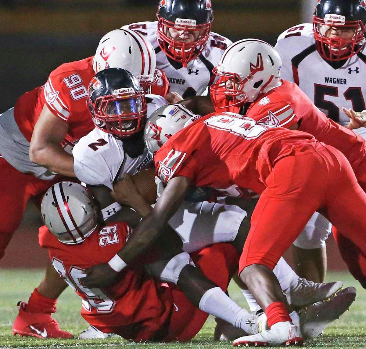 The Rocket defense halts L.J. Butler at the line as Judson plays Wagner at Rutledge Stadium on September 6, 2019.