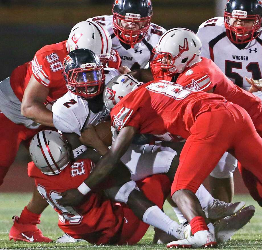 The Rocket defense halts L.J. Butler at the line as Judson plays Wagner at Rutledge Stadium on September 6, 2019. Photo: Tom Reel, Staff / Staff Photographer / 2019 SAN ANTONIO EXPRESS-NEWS
