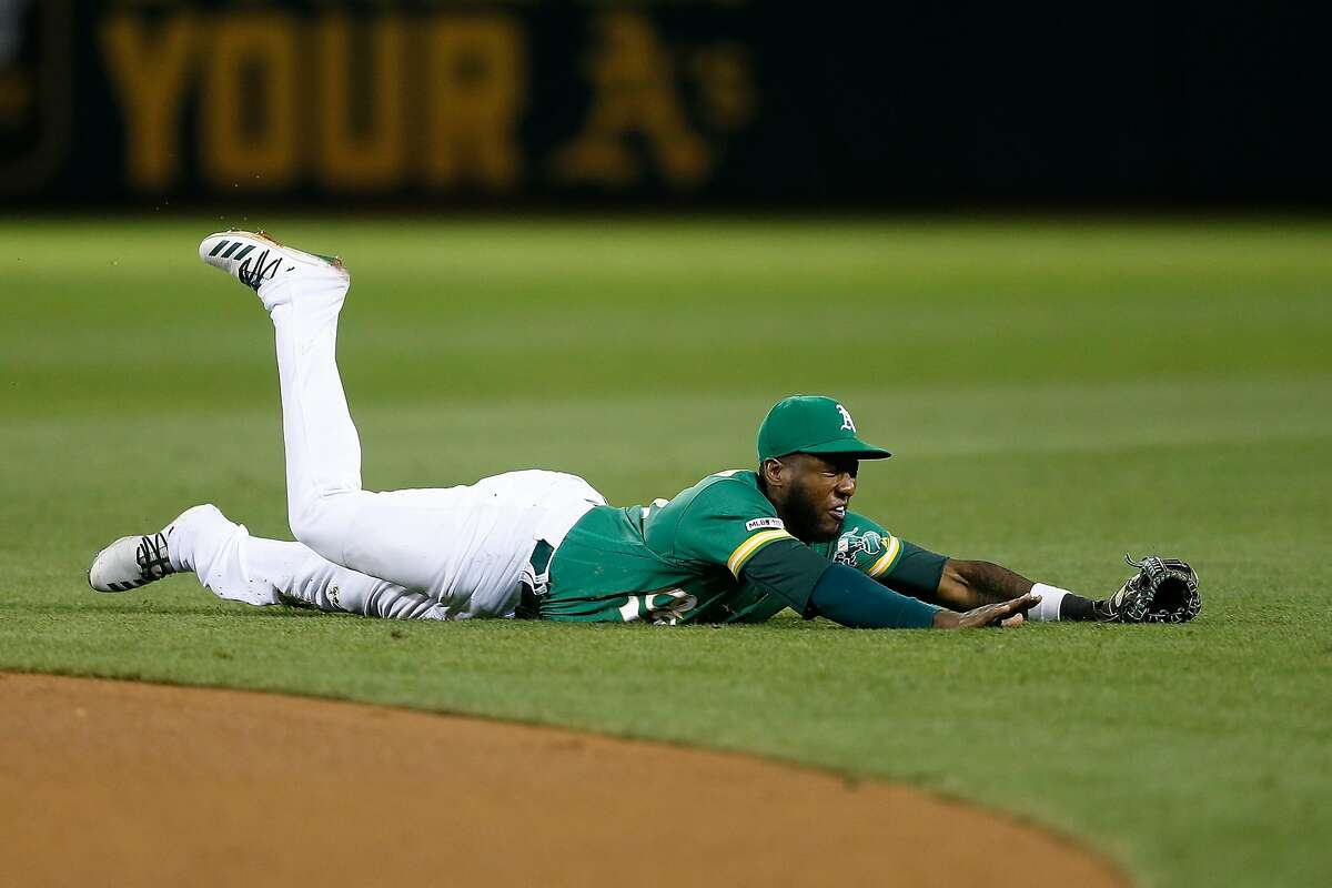 OAKLAND, CALIFORNIA - SEPTEMBER 06: Jurickson Profar #23 of the Oakland Athletics is unable to field a two-run single by Dawel Lugo #18 of the Detroit Tigers in the top of the eighth inning at Ring Central Coliseum on September 06, 2019 in Oakland, California. (Photo by Lachlan Cunningham/Getty Images)