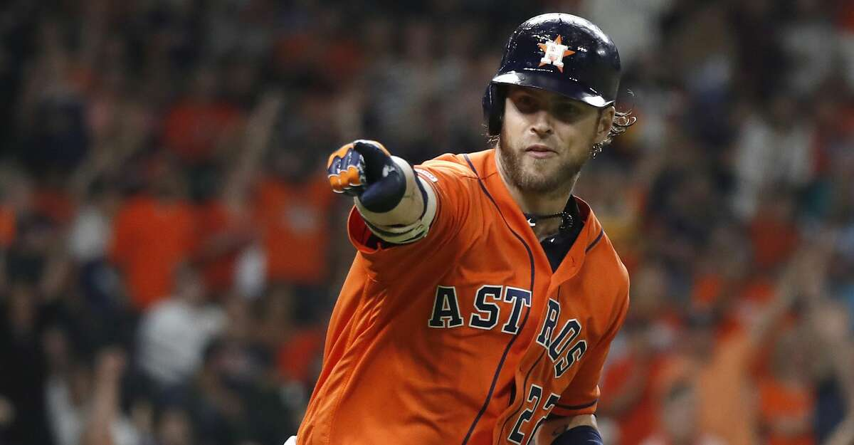 Houston Astros Josh Reddick (22) points to George Springer in the dugout after hitting a home run during the fourth inning of an MLB baseball game at Minute Maid Park, Friday, Sept. 6, 2019, in Houston.