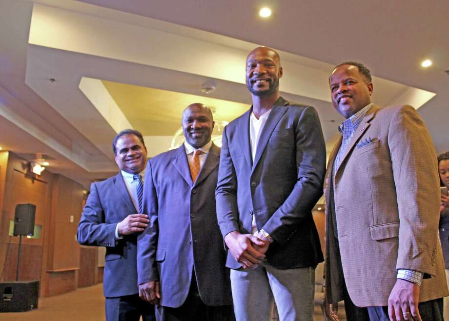 A near standing-room only crowd that included notable VIPs from the business community and local and state elected officials gathered to welcome Lighthouse Church Senior Pastor Keion Henderson and church members and suppports at a ribbon-cutting ceremony hosted by the Fort Bend County Chamber of Commerce on Thursday, Sept. 5, 2019, in Sugar Land. Pictured from left: Fort Bend County Judge KP George, Missouri City Councilman and award-winning journalist Jeffrey L. Boney, Pastor Keion Henderson, State Rep. Ron Reynolds Photo: Kristi Nix / Staff Photo