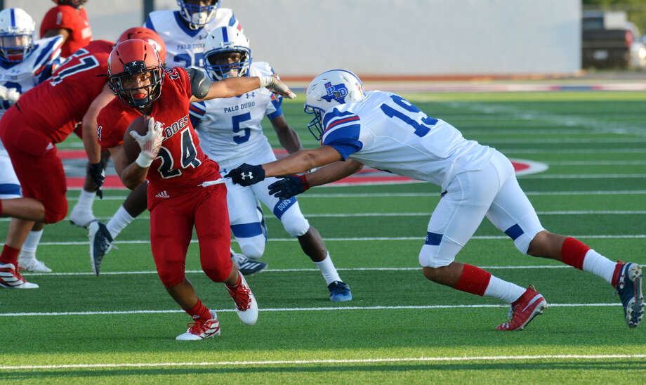 Plainview's Ethan Campos fights through the attempted tackle of Palo Duro's Noel Marquez on his way to the end zone for a 26-yard touchdown run during the first quarter of their non-district high school football game on Friday night in Greg Sherwood Memorial Bulldog Stadium. Plainview fell short in its home opener, falling 32-28. Photo: Nathan Giese/Planview Herald