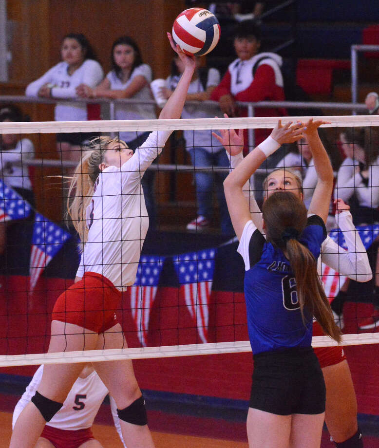 Plainview's Lexie Bennett taps the ball over the head of the Palo Duro defender for a kill during their District 3-5A volleyball match on Friday in the Dog House. Photo: Nathan Giese/Planview Herald