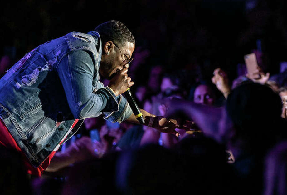 Nelly leans into the crowd for high-fives and handshakes during his performance Friday night at Liberty Bank Alton Amphitheater. St. Louis rapper and recording artist Nelly performs at Liberty Bank Alton Amphitheater. Photo: Nathan Woodside | The Telegraph