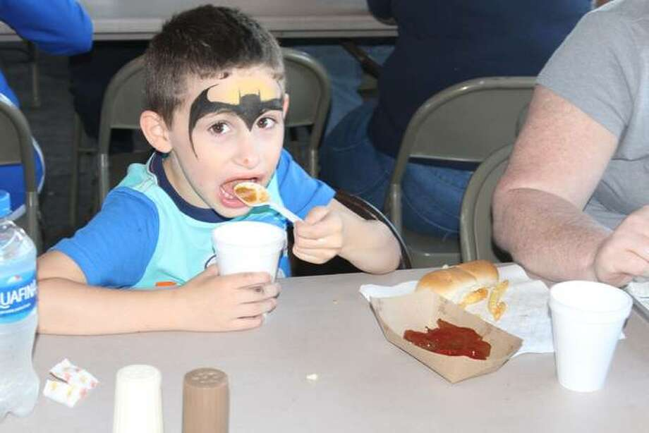 Kayden Taylor, 5, the grandson of Joe and Tina Taylor of Bluffs eats burgoo Friday in Arenzville. Photo: Samantha McDaniel-Ogletree | Journal-Courier