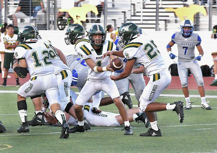 Quarterback Austin Garcia suffered an injury in Nixon's loss to Eagle Pass on Friday. With the loss, the Mustangs are now 0-3 in district play. Photo: Cuate Santos /Laredo Morning Times File / Laredo Morning Times