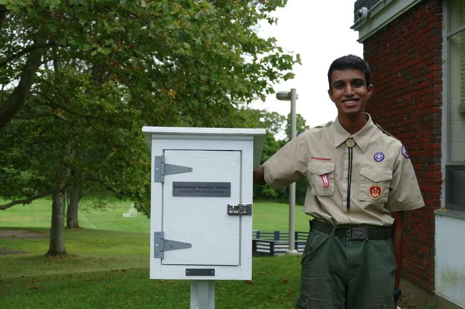 Ridgefield Boy Scout Ajay Natarajan of Troop 76 looks with the weather station he built for Scotland Elementary School students. Photo: Stephen Coulter / Hearst Connecticut Media