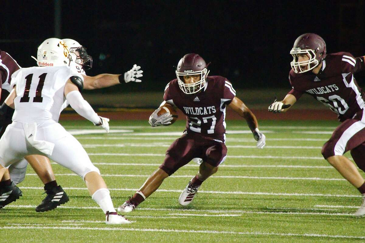 Clear Creek's Rayfield Conley (27) finds a hole in the Deer Park defense Friday, Sep. 6 at CCIS Challenger Columbia Stadium.
