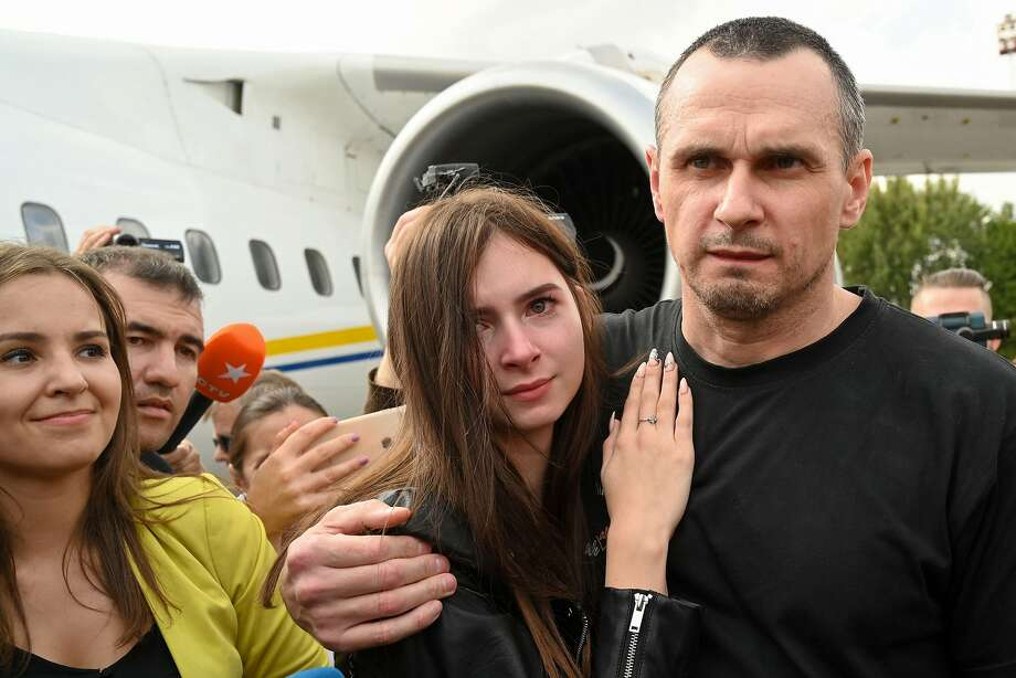 Ukrainian film director Oleg Sentsov embraces daughter Alina Sentsova after disembarking in Kiev. His conviction in Russia for preparing terrorist attacks was denounced abroad. Photo: Sergei Supinsky / AFP / Getty Images