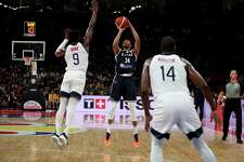 Greece's Giannis Antetokounmpo attempts to shoot past United States' Jaylen Brown at left and United States' Khris Middleton at right during phase two of the FIBA Basketball World Cup at the Shenzhen Bay Sports Center in Shenzhen in southern China's Guangdong province on Saturday, Sept. 7, 2019. United States beat Greece 69-53.
